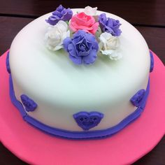 My first fondant cake with gum paste flowers.  Wilton course 3.