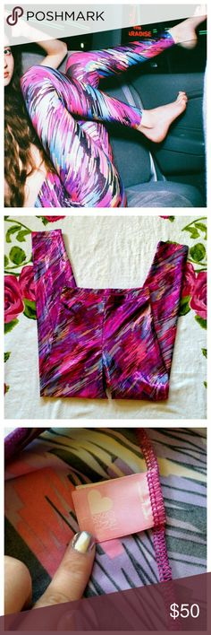 AA Shiny Leggings From American Apparel, these shiny purple leggings scream 80's! In perfect condition, took the tags off but never wore. Leggings are form fitting and flattering in a fun brushed print that's shiny and holographic! Perfect for raves, Halloween, festival season, or getting that perfect 80's workout look! From American Apparel's Cali Sun & Fun collection, no longer being made or sold by AA! American Apparel Pants Leggings