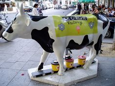 'Les Temps Modernes' (Modern Times) by Frédéric Périmon;  Cow Parade in Paris, France  (2006);  photo by tarnouche, via Flickr    ...Notice the spigot by the udder and the hand coming out of the 'door' in the cow's stomach to put the lid on the ice cream container!...