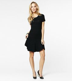 Flirty at the hem with a bold pintuck pattern, this flared dress is perfect for daytime. Give it some edge with a faux leather waist-defining belt. #wishlist #dynholiday