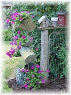 Watering cans as garden art