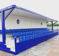 Shipping container seating for a crown watching sport or entertainment.