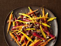 Marmalade-Glazed Carrots With Candied Pecans recipe from Food Network Kitchen via Food Network