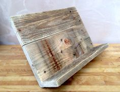 A handmade cookbook or tablet stand made from reclaimed pallet timber. Each item is constructed from unique rustic pallet timber and handwaxed with a clear Briwax for protection. The perfect kitchen accessory for any keen cook. Dimensons: TBC  All our items ship with a fully insured courier or Royal Mail service and are securely wrapped before dispatch which can take upto 3 working days after placing your order. If you need an item quickly please contact us before ordering to see if we can…