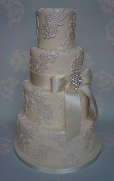 Four tier lace applique wedding cake..love it!