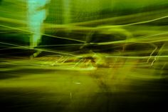 Abstract 7460. Dark and mysterious capture of the city in green and yellow hues. Starting from $238.