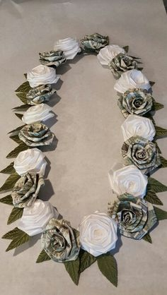 Money lei with ribbon roses