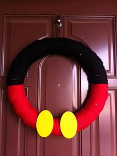 Mickey Mouse Yarn Wreath by pinkolicious on Etsy, $40.00 - buttons are white though!