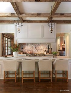 Open #kitchen with brick and rustic beams. #design-Liked by http://deliciousdecors.com/