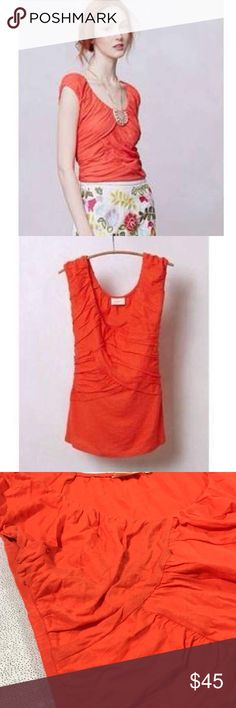Anthropologie Deletta Wynwood Orange Top 🍊 Anthropologie, Deletta, uber gorge Wynwood top in perfect orange. Obsessively romantic and easy, breezy, and beautiful than anything else this orange. Tucked into a skirt or worn over jeans by itself (and a lovely necklace, of course) or with a snazzy cardigan-this will be the one you wash the most because it comes out every other day this summer. Super soft. The ruching (the creases and layers) hide any belly you might be self conscious about…