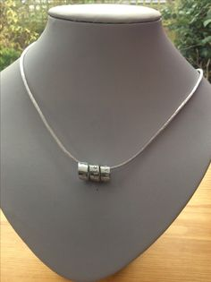 Hand stamped Aluminium spiral pendant with hidden message. From Mums Jewellery Shed on Facebook