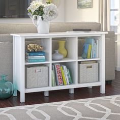 Open and airy, the 6 Cube Storage Bookcase breathes contemporary life into any room in the home or office. Display art or collectibles to accent your home office, or bring a modern flair to work and store books, binders or reference materials. Six storage cubes with two adjustable shelves let you customize the Bookcase to showcase knickknacks or materials of varying shapes and sizes. Closed side panels and an airy open back coordinate with existing decor as you display your prized…