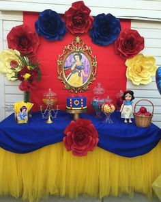 Snow white princess inspired cake table #babys2ndbirthday #snowwhiteparty #paperflowerbackdrop Glass Jars for #CandyBuffet Gold princess frame and gold cake stand #tulleskirt Party Table Designed by Jessica Nicole IG: jayen_dubb