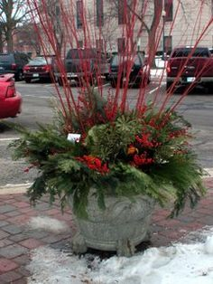 Outdoor Planters filled with Christmas Finery for the Holidays.