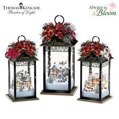 Thomas Kinkade Illuminated Holiday Centrepiece Collection is part of Christmas arrangement With Lanterns - A FIRST! Metal lanterns with fully sculpted Thomas Kinkade holiday scenes, Always in Bloom® arrangements, floating light strands Limited edition! Lantern Table Centerpieces, Holiday Centerpieces, Lanterns Decor, Xmas Decorations, Metal Lanterns, Lantern Crafts, Fall Lanterns, Outdoor Decorations, Christmas Projects