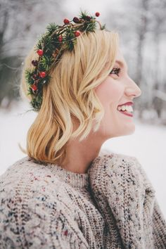 Evergreen crown, cozy sweater, and red lips.