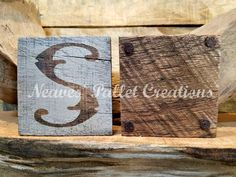 """RECYCLED WOOD PALLET:  We were asked  to make some  Country-looking Monogrammed coasters. We normally do 4 to a set but they didn't need 4 coasters so we made 2 monogrammed """"S"""" .The set of 2 coasters sells for $3. We paint, stain. poly-coat, and then we add small felt feet so they do not scratch the surface that they sit on.If you have an idea for a set of coasters, send us a message and we would love to make them for you. All of our coaster sets come ready to give as a gift. Item #1,102"""