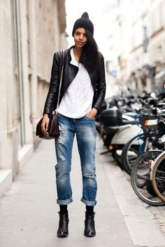 Boyfriend denim with a street-cool finish via a beanie, ankle booties, and a leather jacket. #streetstyle
