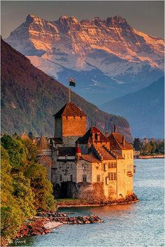 Chateau de Chillon is an island castle located on the eastern shore of Lake Geneva in Switzerland. Places Around The World, The Places Youll Go, Places To See, Around The Worlds, Beautiful Castles, Beautiful World, Stunningly Beautiful, Beautiful Places To Visit, Places To Travel