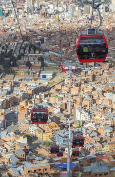 Cable cars carry passengers between the cities of El Alto and La Paz, Bolivia.