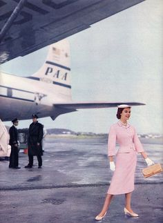 Pink Suit 1960s, with Pan Am DC-7 in the background.