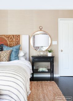 Rug or blanket on headboard to cover/add interest