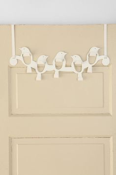 I really like this hook... much better looking that traditional over the door hooks!