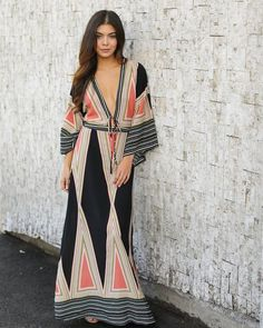 Styled to perfection in our Tanzania Kimono Maxi Dress! This resort ready must have maxi dress has a flattering and chic fit with an on trend geo print. Based i