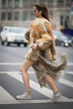 What a mix a printed Burberry dress and oversized fur paired with worn in chucks. #NYFW