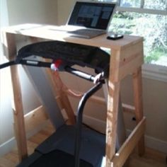 interesting - DIY shelf/desk over treadmill ... love this, love working standing up ... although don't necessarily love being on the treadmill!
