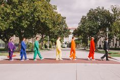 Whimsical Rainbow Wedding: Here are the guys each in a different color tux.