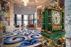 Baldi Boutique in Saigon - Monumental Clock - 3 meters high - in malachite mosaic, 24K gold-plated bronze, green lead crystal.