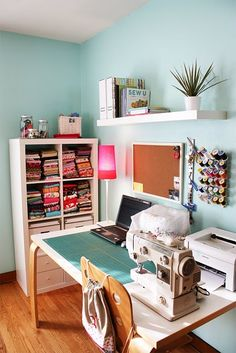 Crafty sewing room - yes! with space for printer and laptop on the table. and the spools of thread on the wall...