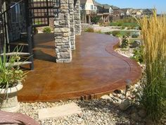 Acid stained patio for concrete hardscaping in the Arvada / Golden / Wheat Ridge area of Colorado. Brickform coffee concrete sealer, sealed with solvent-based sealer and slip resistance additive.