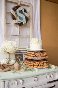 Love this dessert table with treats displayed on a vintage oven! (image: Andrea Dahlberg Photography).