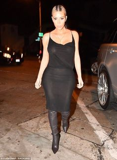 Goddess:The 37-year-old star and businesswoman went braless in her slightly sheer black dress, which featured a draped neckline and skintight skirt