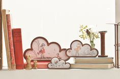 This stunning set of cloud art is free standing, but can also be wall mounted.   Add a bit of 'silver lining' to your home, with this beautiful series of clouds featuring a range of children caught in the autumn wind.  These illustrations are from vintage storybooks from the early 1900's.