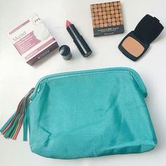 Aqua cosmetic bag Gently used Aqua cosmetic bag. May also be used as a clutch. Size is small to medium. <<All cosmetic bag purchases or clutches will come with a FREE sample inside>> Bags Cosmetic Bags & Cases