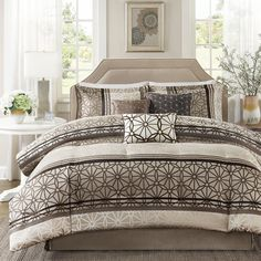 With a brown and taupe color scheme, this lovely comforter set is machine washable with a lovely interlocking medallion pattern, adding class to the bedroom. The set includes a comforter as well as matching shams, bedskirt and decorative pillows.