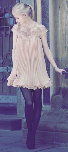 Like the pale girly dress with black tights