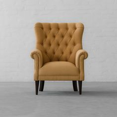 Old world charm meets modern day craftsmanship!  Product Link - http://www.gulmoharlane.com/products/dalhousie-armchair-collection-2  #dalhousie #armchair #udaipurnatural #cotton #natural #fabric #amber #color #newcollection #handcrafted #furniture #tufted #buttons #britishclassic #earlycentury #inspiration #homedecor #interiors #interiordesign #decor #livingroomdecor #homestyling #gulmoharlane