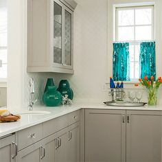 Use Plascon  Whisper [B5-E2-3] in Velvaglo water-based enamel for painting kitchen  cabinetry to provide a sharp contrast with white w...