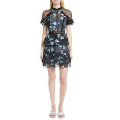 Bits of pale blue lining peek from beneath the beautiful floral fil coupe fabric that forms this playfully ruffled minidress. Covered buttons and ditsy mesh a…