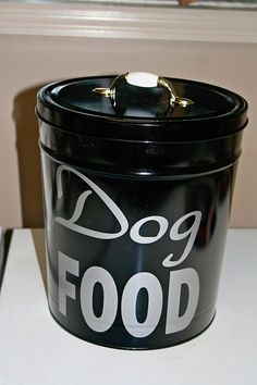 DIY PET FOOD CANISTER :: Made from old popcorn tin...love the idea of putting a handle on top! This looks alot like those nice (but expensive) Harry Barker Dog & Cat Food Storage tins.
