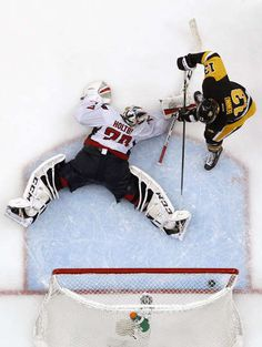 MAY 10: Nick Bonino #13 of the Pittsburgh Penguins scores past Braden Holtby #70 of the Washington Capitals to win 4-3 in overtime in Game Six of the Eastern Conference Second Round during the 2016 NHL Stanley Cup Playoffs at Consol Energy Center on May 10, 2016 in Pittsburgh, Pennsylvania. (Photo by Justin K. Aller/Getty Images)
