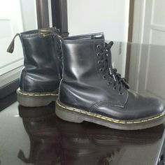 Authentic Doc Martens - Black Combat Boots In fantastic condition with hardly any wearing on the sole or heel of the boot (see 2nd picture)! Black, not glossy but not matte, hardly worn but there are crease marks and scuffs on tip of boot (see 3rd picture). I LOVE offers!! :) Dr. Martens Shoes Combat & Moto Boots