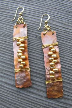 Idea: hammered copper shapes with lacing and contrasting metal shapes repeated.jpg More