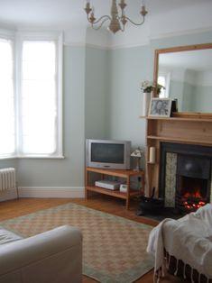 The front room, painted in Laura Ashley's Pale Eau De Nil