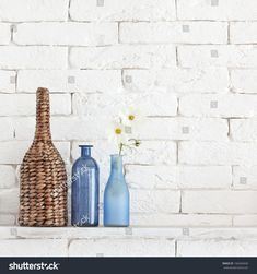 Decorative shelf on white brick wall with vintage bottles and wicker jars on it Decorative Shelf, White Brick Walls, Room Shelves, Vintage Bottles, Wicker, Photo Editing, Royalty Free Stock Photos, Jars, Image
