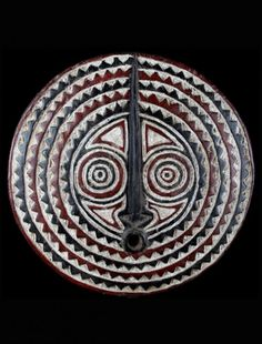 Burkina Faso sun disk mask. These Bwa African masks are used in agricultural ceremonies to celebrate farming and bless the crops.  This particular mask of the Bwa signifies the sun, on of the important components to yielding a healthy crop.